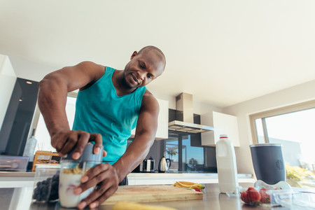Man preparing breakfast in kitchen
