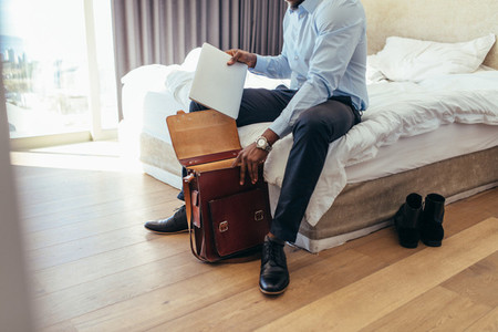 Man preparing his bag to go to office