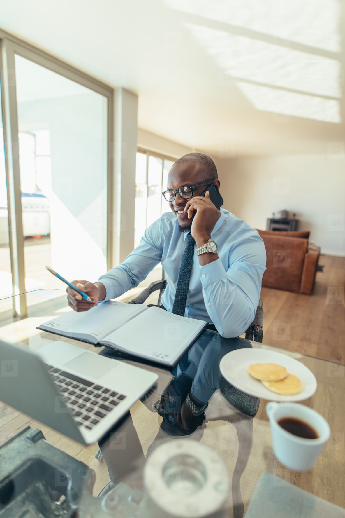 Businessman talking over mobile phone at work