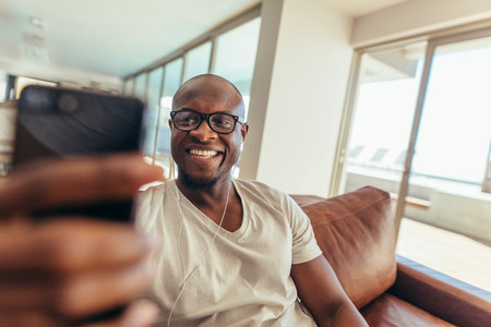 Man using mobile phone for video call