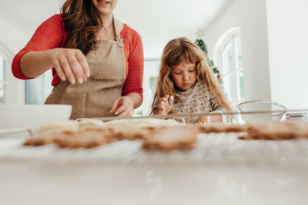 Woman and girl making Christmas cookies