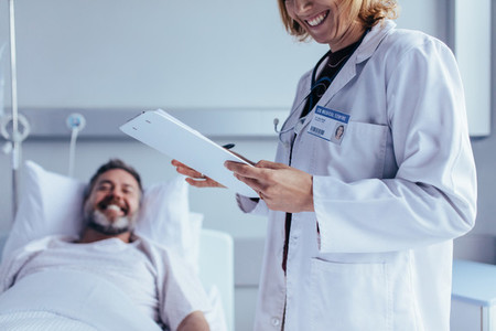 Healthcare worker with reports visiting male patient