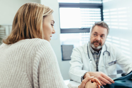 Patient talking with doctor during a consultation in clinic