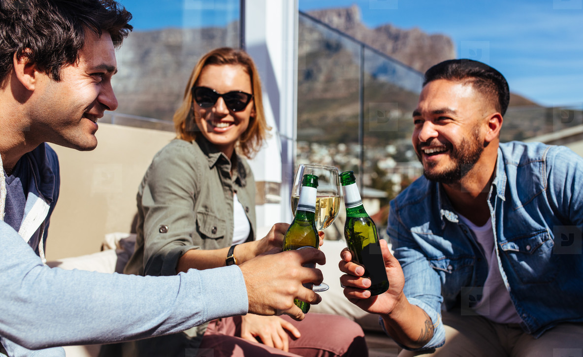 Millennial having beers at rooftop party