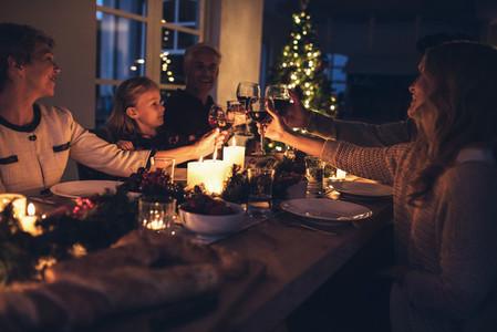 Happy extended family having christmas dinner at home