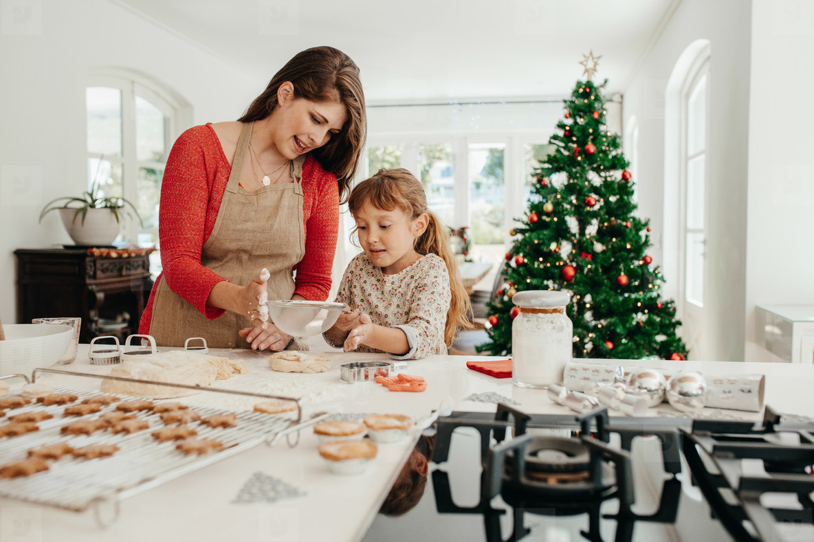 mother and daughter making christmas cookies - Making Christmas Cookies