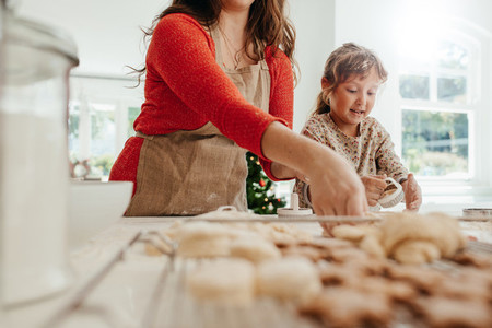 Mother and child making cookies for Christmas