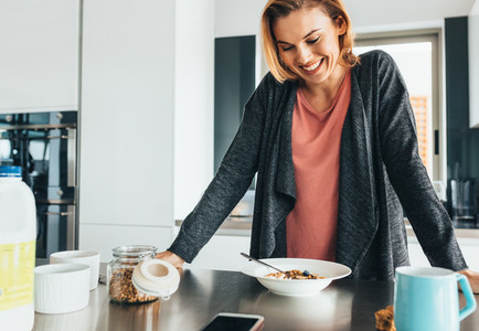 Woman at dining table with breakfast