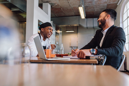 Restaurant owner having a friendly conversation with employee