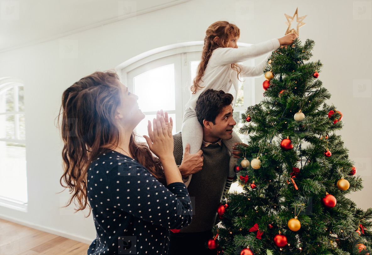 Family celebrating Christmas at home
