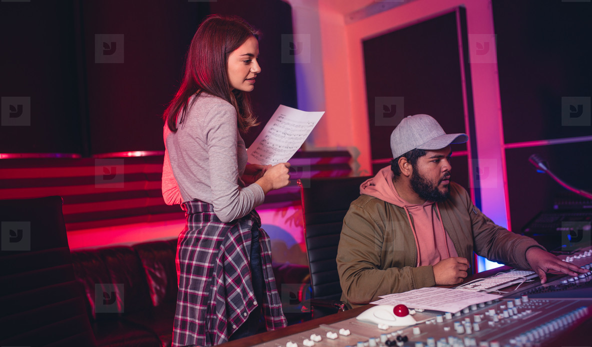 Sound engineers working in music recording studio