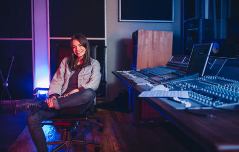 Female music composer at sound recording studio
