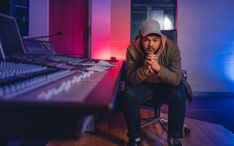 Music composer in sound recording studio