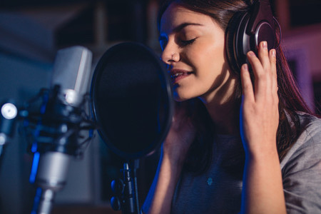 Female singer in recording studio