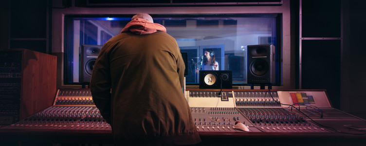 Musicians producing music in professional recording studio