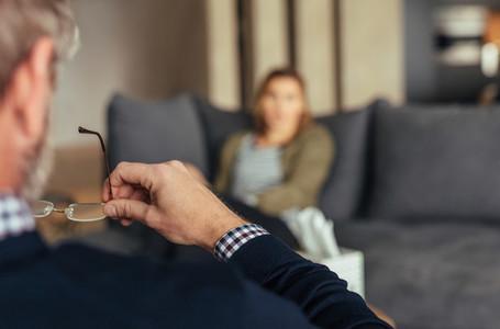 Psychologist understanding problems of a woman patient