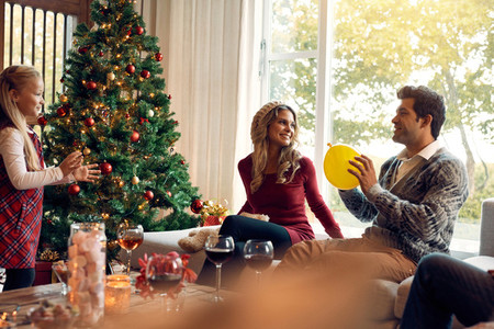 Young family having fun at home during christmas