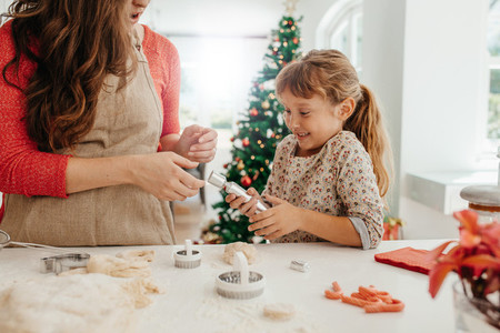 Mother and daughter making cookies for Christmas