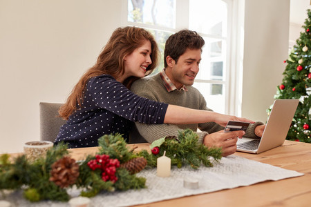 Couple doing online shopping for christmas