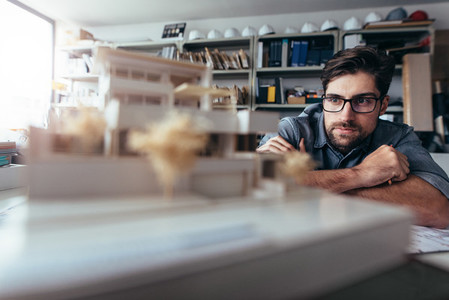 Designer thinking about new architectural ideas