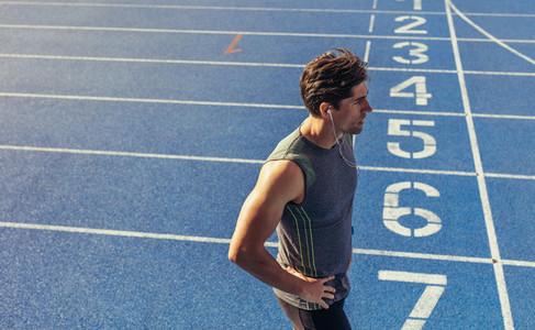 Sprinter standing on running track