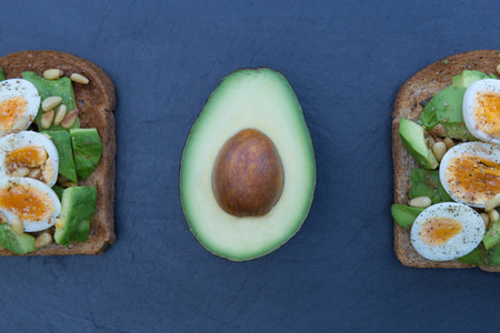 Avocado eggs on toasted brown bread