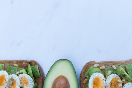 Healthy breakfast of eggs avocado on toast