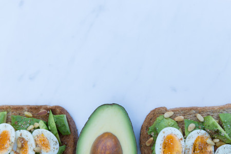 Healthy breakfast of eggs avocado on toast