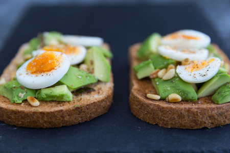 Closeup of eggs and avocado on toast
