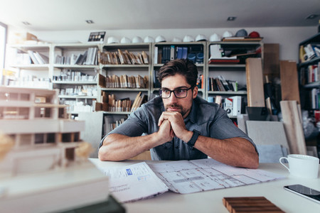 Young architect thinking about new construction ideas
