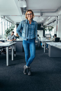 Young female manager standing in office