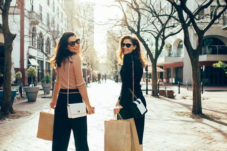 Friends having fun on a shopping spree in the city