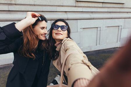 Best friends taking a selfie outdoors on the street