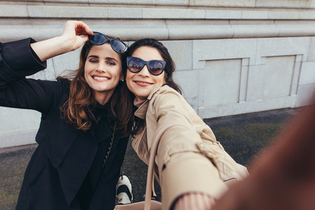 Beautiful female friends taking a selfie