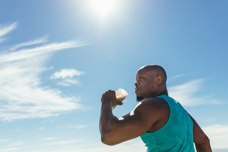 Athlete drinking health drink during workout outdoors