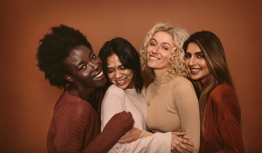 Group of cheerful young women standing together