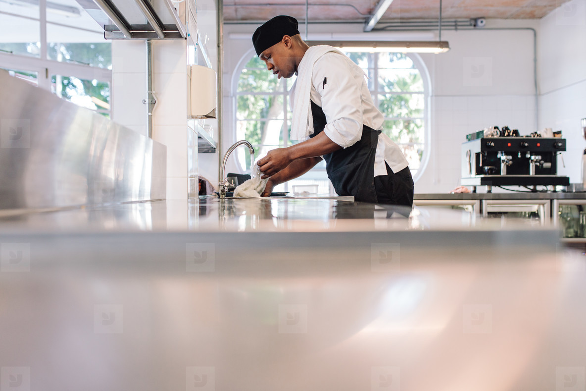 Man cleaning the kitchen counter