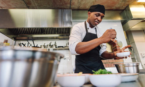 Chef cooking food in restaurant kitchen