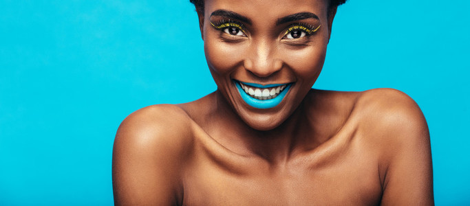 Beautiful smiling woman with vibrant makeup