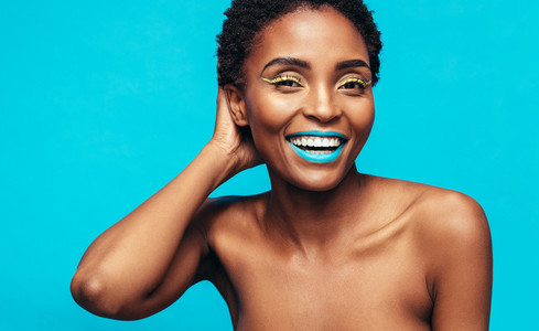 Woman with beautiful skin and vivid makeup