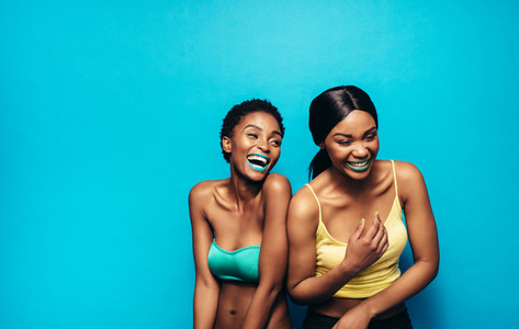 Cheerful women standing together and laughing