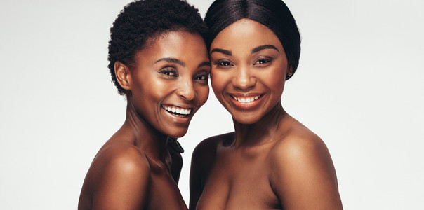 Two women standing together and smiling
