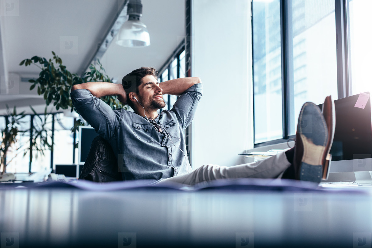 Male designer sitting relaxed at his workplace