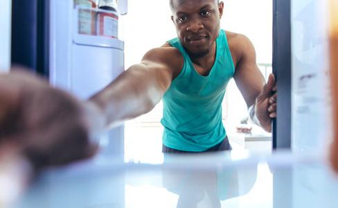 Man using refrigerator at home