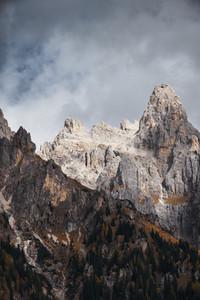 Dark cloud over rocky mountains