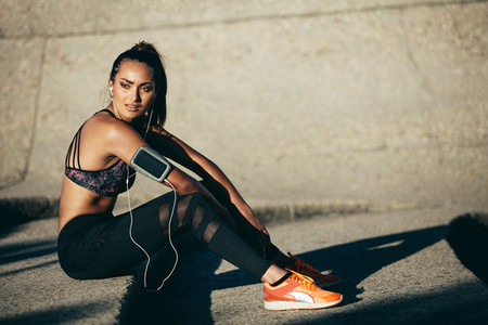 Slim and fit woman resting after exercising