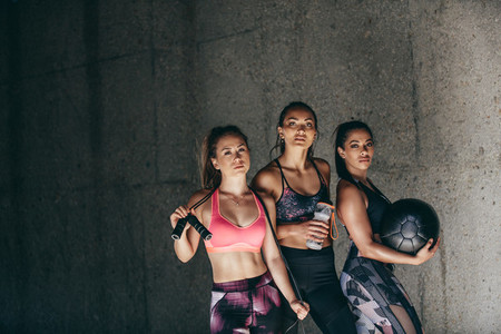 Female friends standing together after workout session