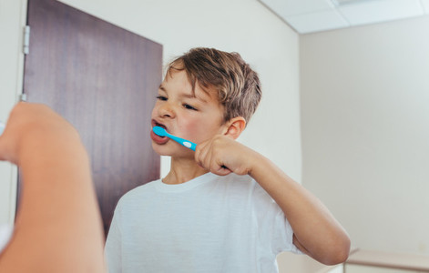 Little  boy brushing teeth in bathroom