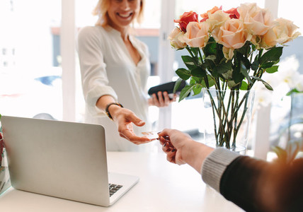 Client paying for flowers with debit card