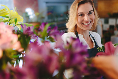 Smiling florist working in her shop